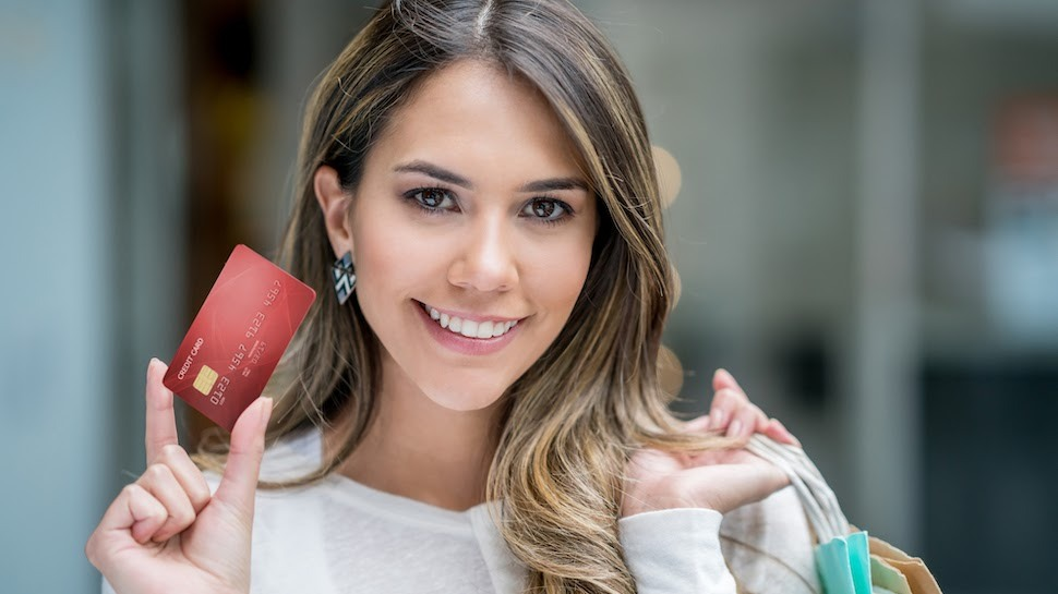 Photo of a woman holding a credit card