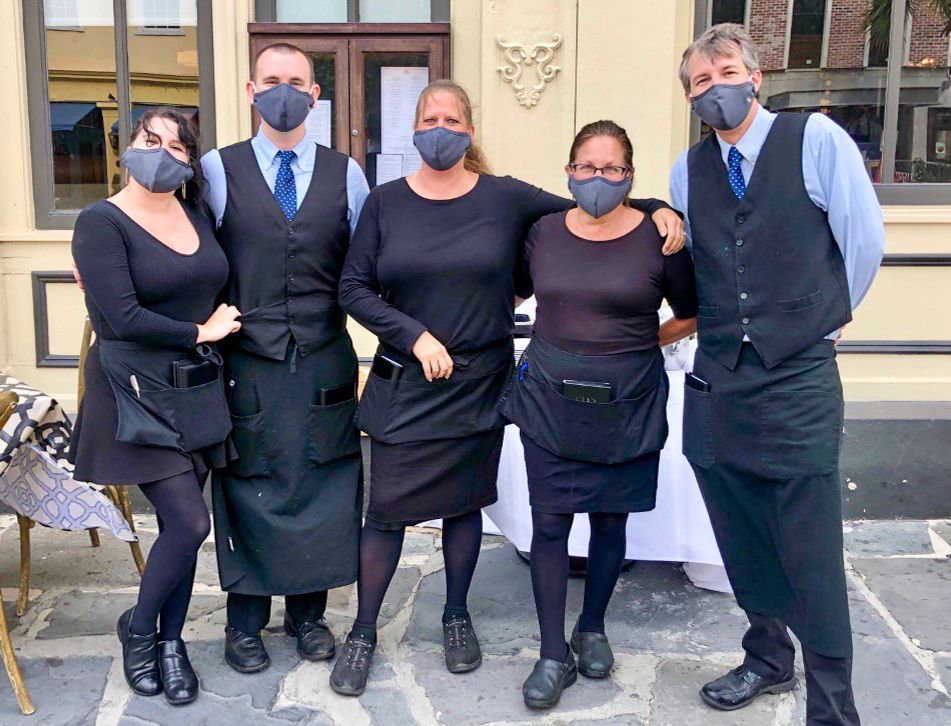 High Cotton staff posing and wearing masks