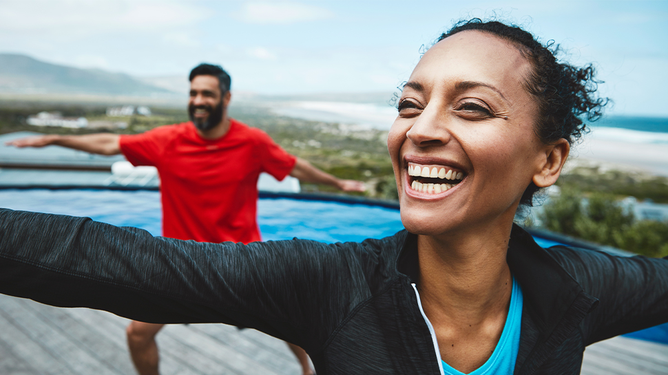 Photo of two people laughing and stretching