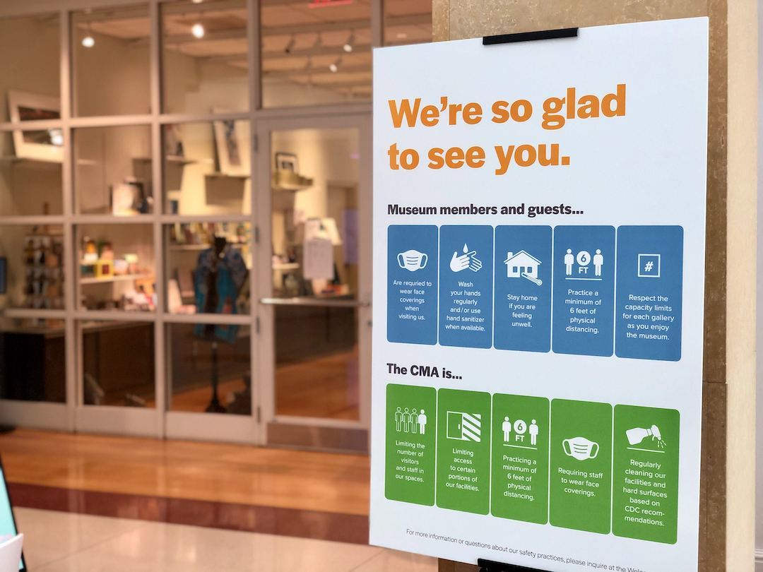 Signage with safety procedures on display in the lobby at the Columbia Museum of Art