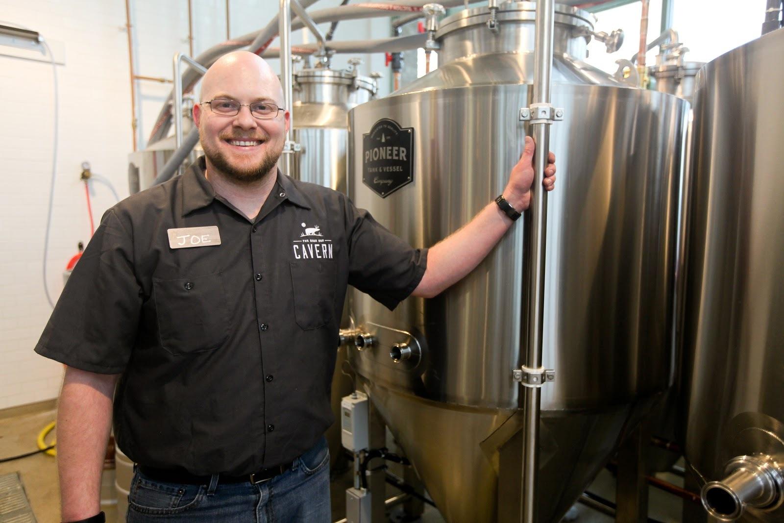 man in front of beer