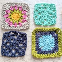 Four crochet squares on a table top