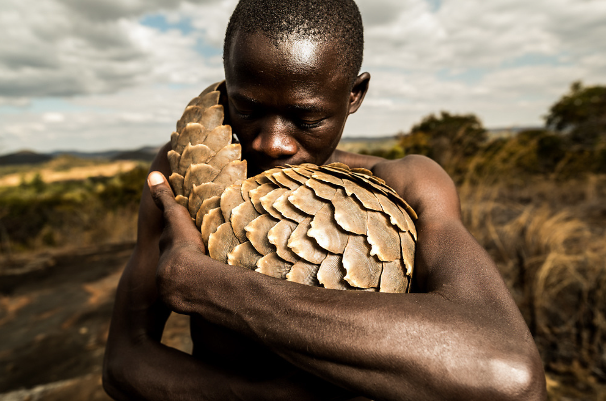 Man with Pangolin