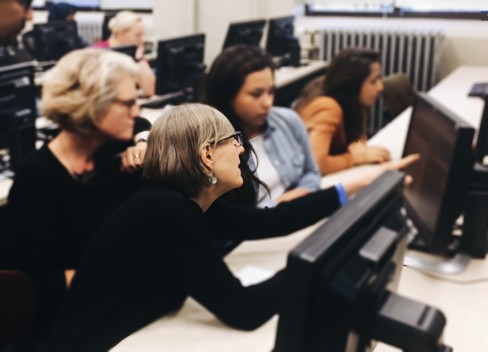 this image shows project members working with volunteers at a transcription session
