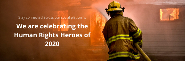 Banner image of Firefighter hosing down a burning house