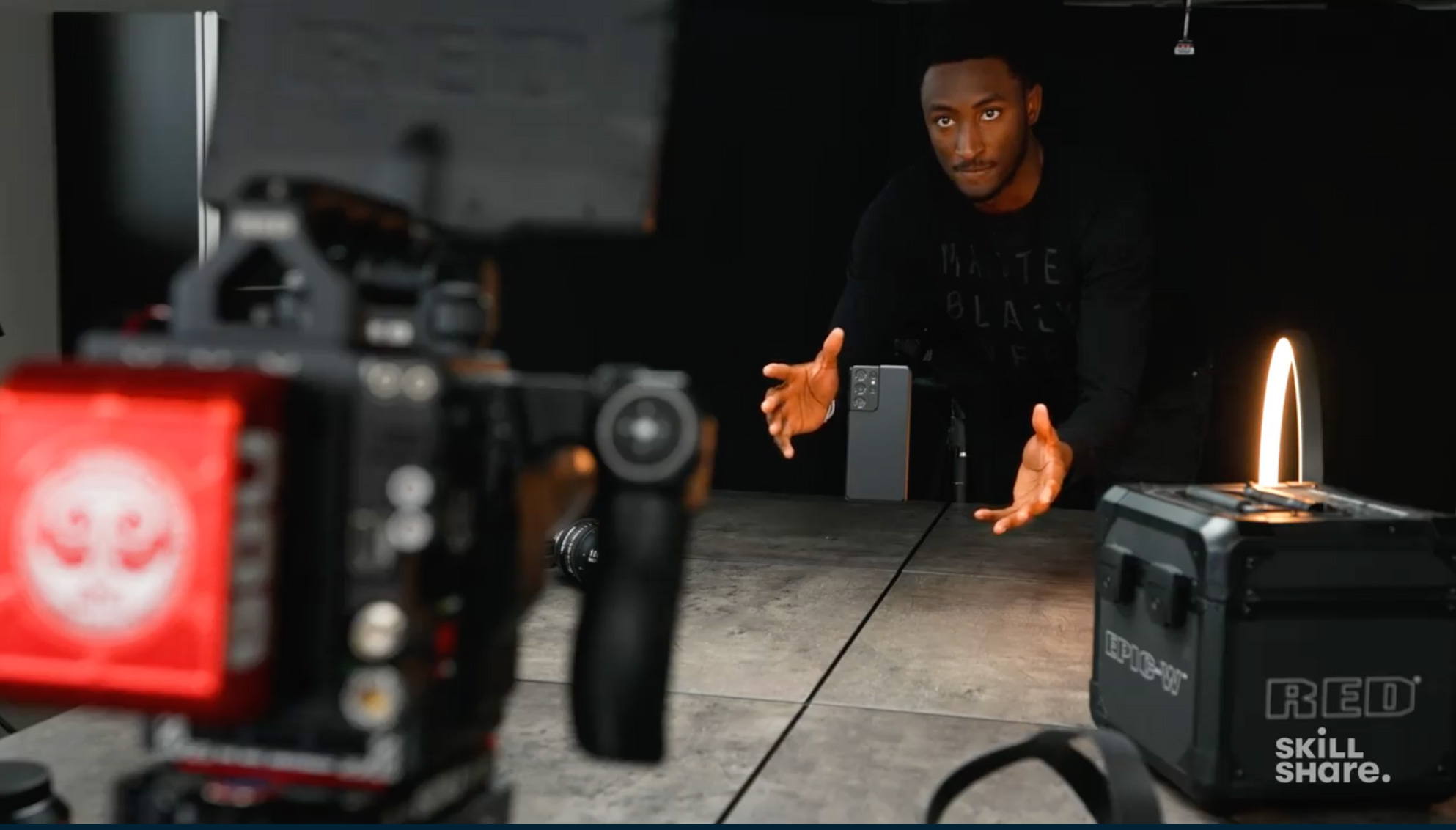 MKBHD filming a tech review with RED camera