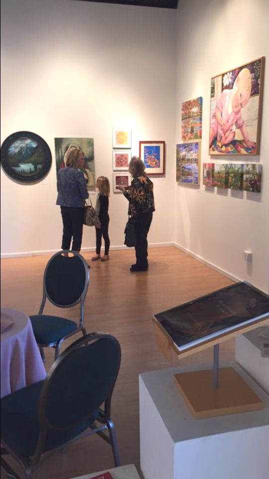 Art lovers appreciate paintings by Iron Range area artists at The First Stage Gallery.