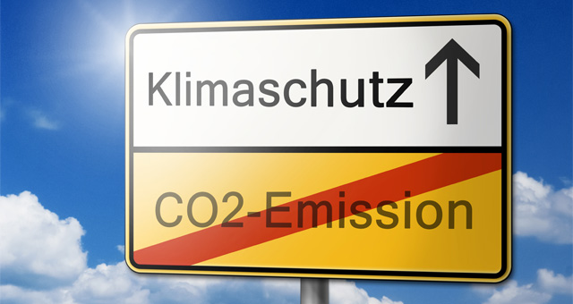Ortseingangsschild: Klimaschutz rauf und keine CO2-Emissionen