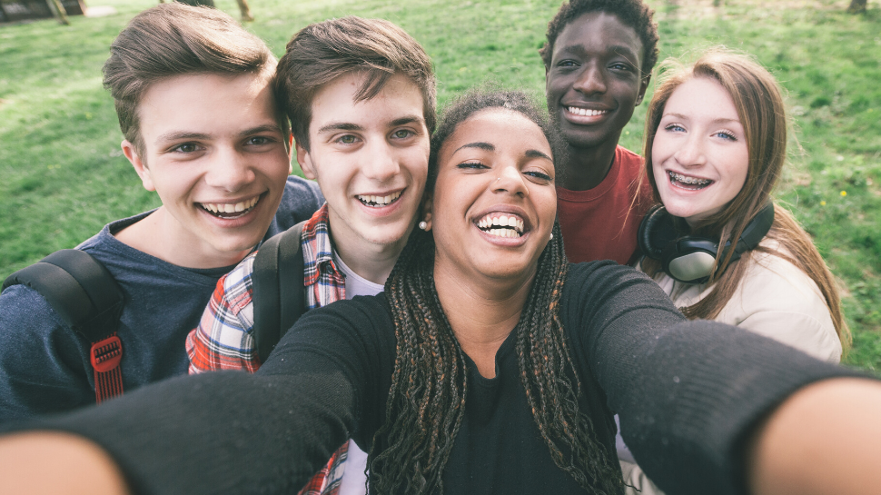 A group of Furman University students taking a selfie