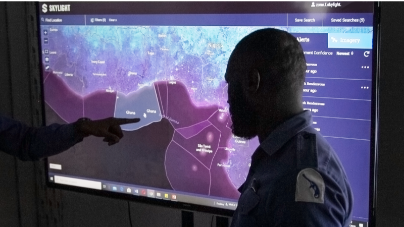 A watchkeeper analyzes Skylight rendezvous alerts at an operations center in Accra, Ghana. (MMCC Zone F Photo)