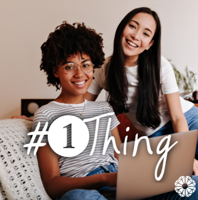 two women in front of a laptop with #1Thing logo