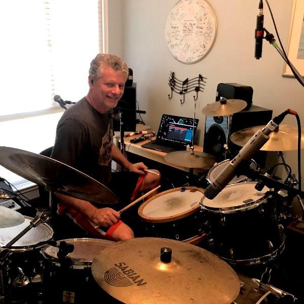 Berkeley Lab scientist Marcus Day playing his drumkit.
