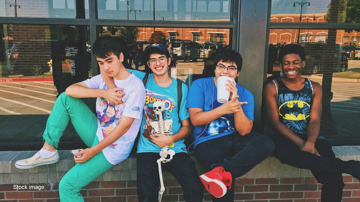 Stock image of young men hanging out at a train or bus station