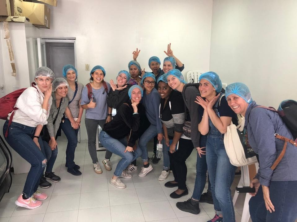 Kroc School students touring the bakery at Investing Hope Foundation.
