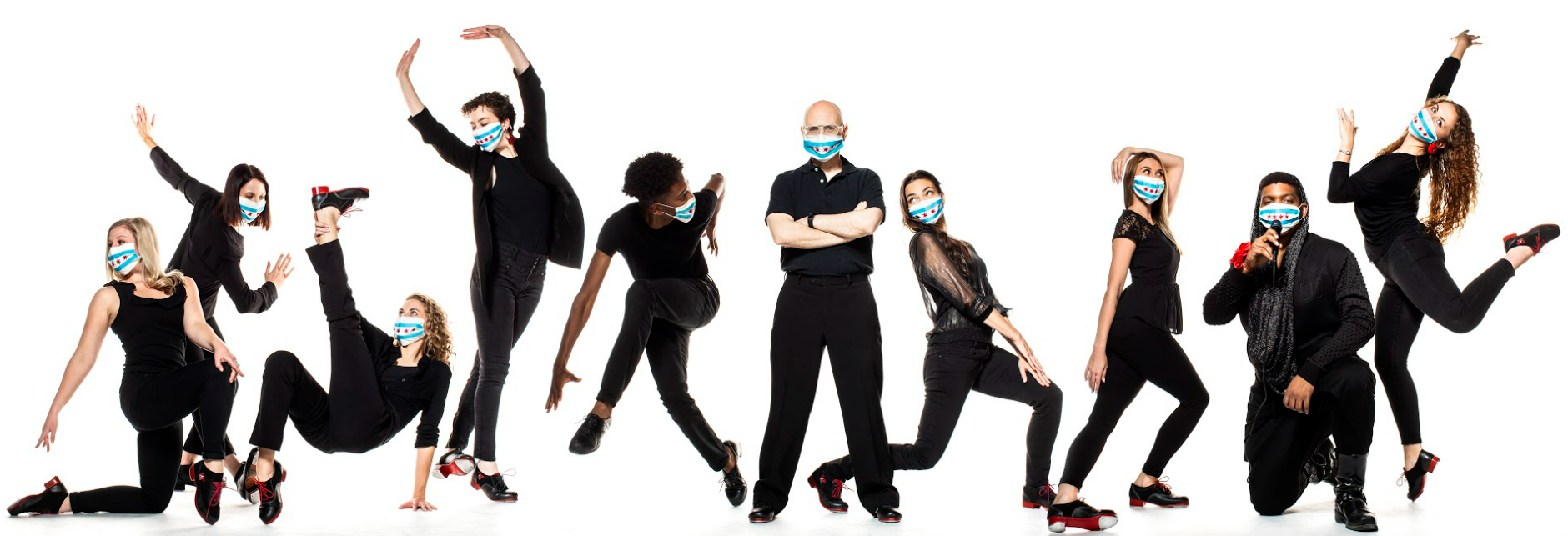 10 dancers dressed in black wearing blue surgical masks arranged in a row in various poses