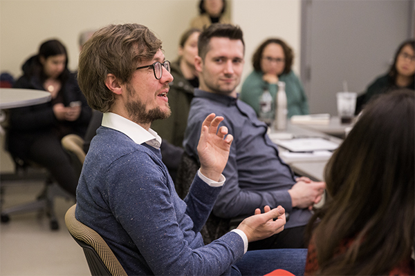 A photo of a J-School classroom showing Alex Droessler in the foreground.