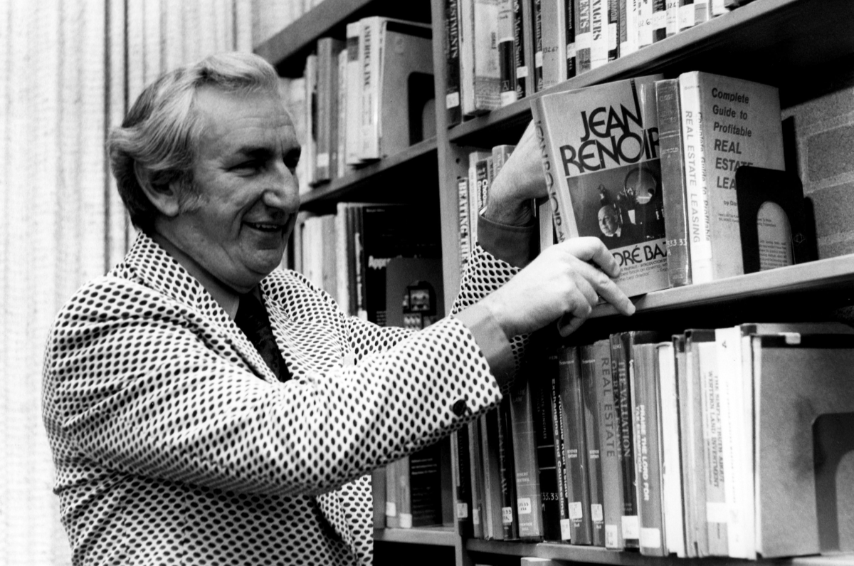 1976 - The Library reaches a collection high: Director Peter Bury shelves the 100,000th book.