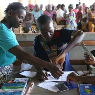 Photo: Cash transfer payments in Freetown, Sierra Leone, 2015 (Dominic Chavez/World Bank, via Flickr, CC BY-NC-ND 2.0)
