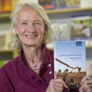 Photo: Camilla Toulmin holding her new book (Mike Goldwater/IIED)