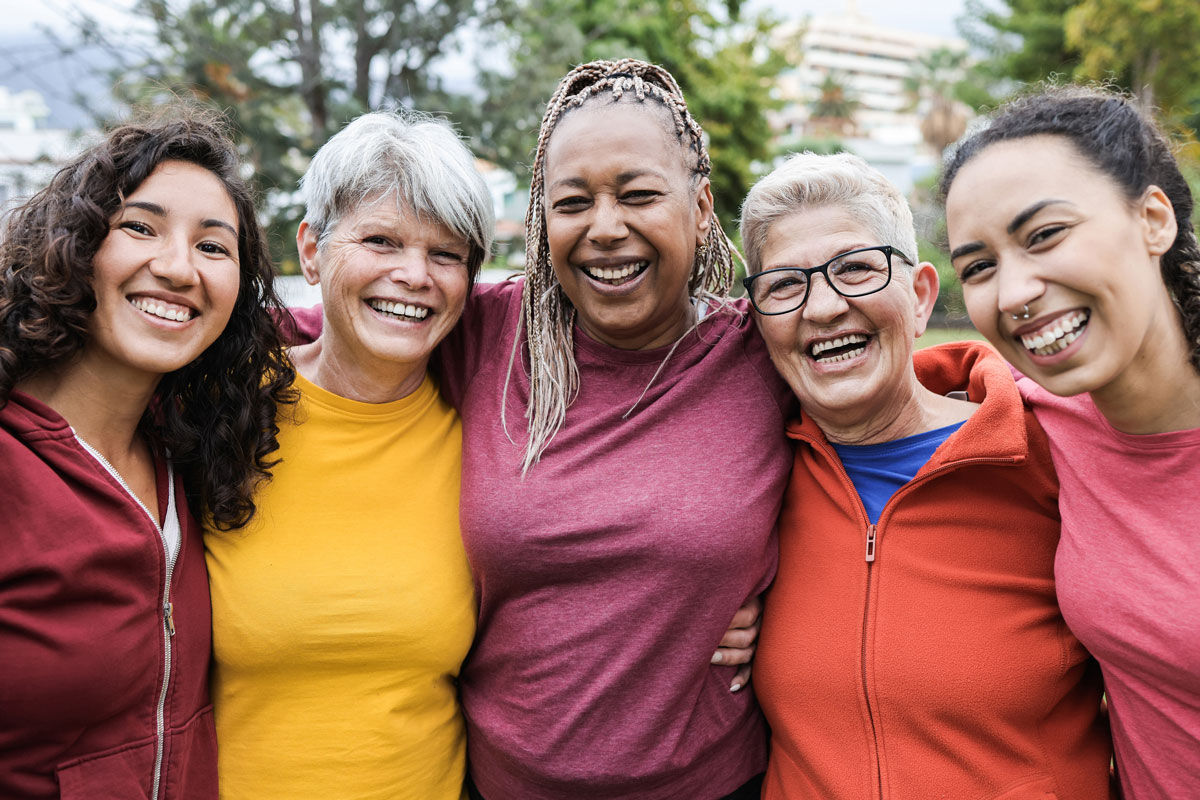 a group of happy, smiling, multigenerational women