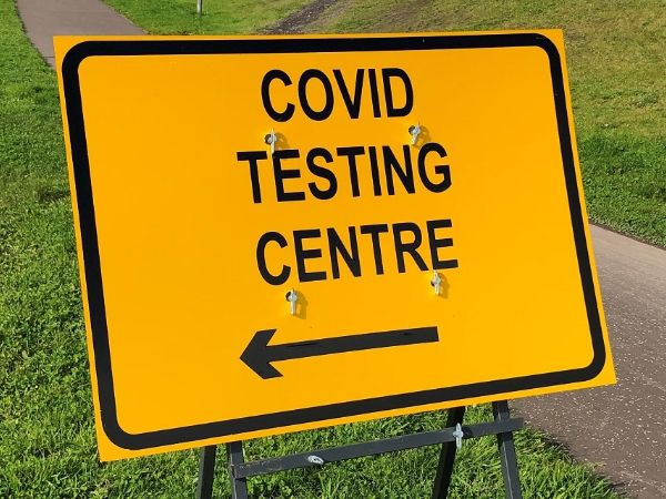 Road sign reading 'Covid Testing Centre'