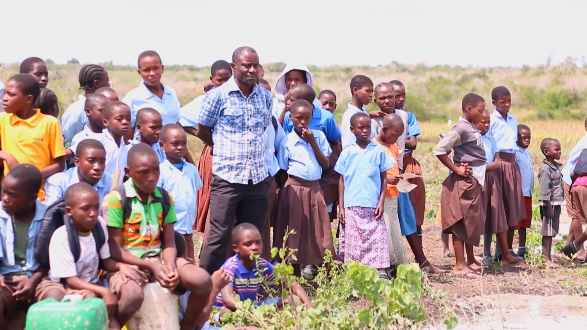 Photo of Emmanuel Baya teaching organic farming techniques to children in his care.